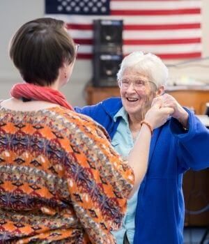 Caregiver Dancing With Senior