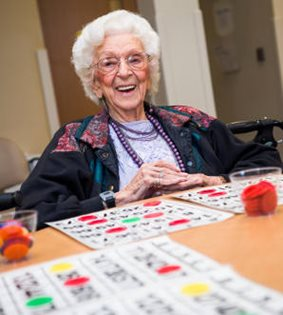 senior enjoys social activities at InnovAge PACE center