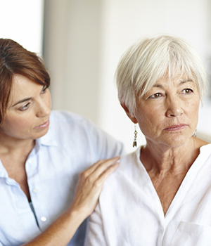 caregiver supporting older adult