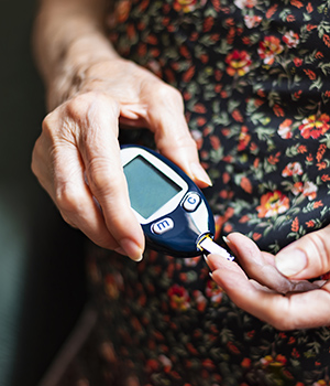 Senior woman checking glucose levels