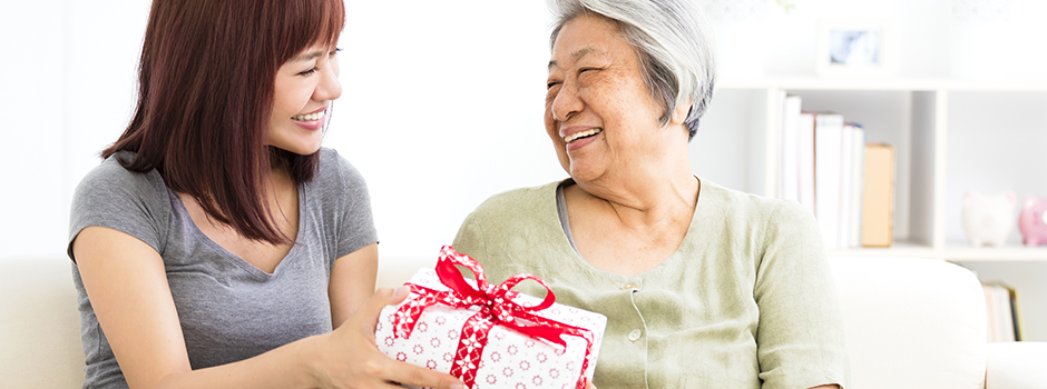 Caregiver and older adult exchanging gifts